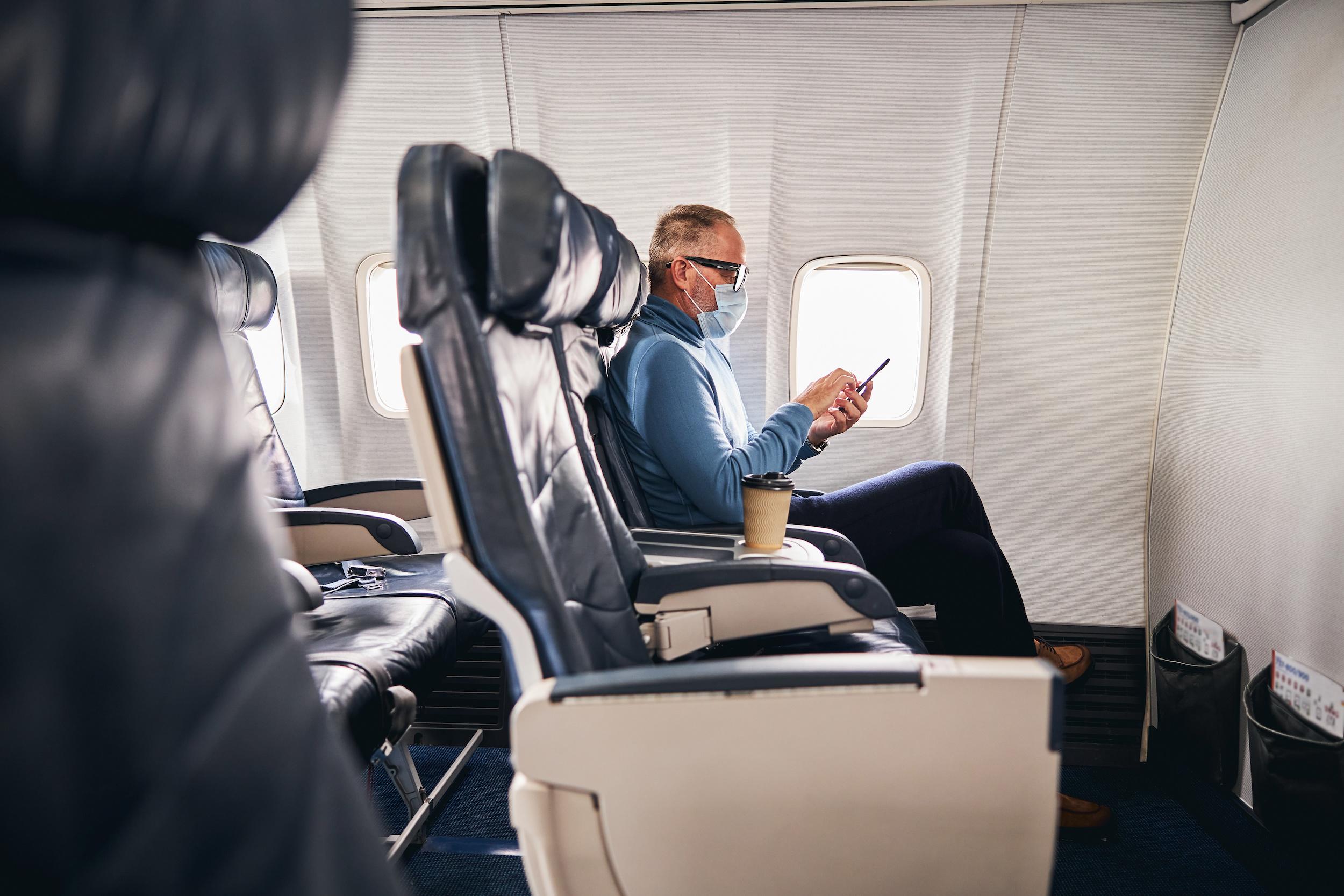 Passenger using phone.